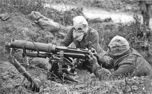 1024px-Vickers_machine_gun_crew_with_gas_masks