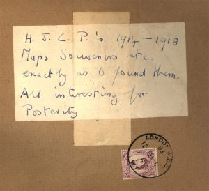 Brown paper envelope with a hand-written label reading H.J.C.P.'s 1914-1918 Maps, Souvenirs, etc. exactly as I found them. All interesting for Posterity.