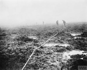 THE BATTLE OF PASSCHENDAELE, JULY-NOVEMBER 1917 (CO 2253) Assault on Passchendaele 12 October - 6 November: Canadian Pioneers laying tape through the mud for a road to Passchendaele. Copyright: © IWM. Original Source: http://www.iwm.org.uk/collections/item/object/205193444