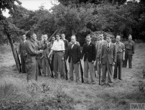 THE HOME GUARD IN THE SECOND WORLD WAR (H 2007) Local Defence Volunteer (LDV) recruits learning rifle drill at Buckhurst Hill, Essex, 1 July 1940. Copyright: © IWM. Original Source: http://www.iwm.org.uk/collections/item/object/205197199