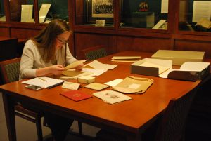 Peirs Project Intern, Meghan O'Donnell '18, examines additions to the Peirs Papers in Special Collections & College Archives, Musselman Library, 2017.