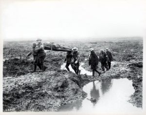 Canadian soldiers carrying the wounded. Photo via Wikimedia Commons.