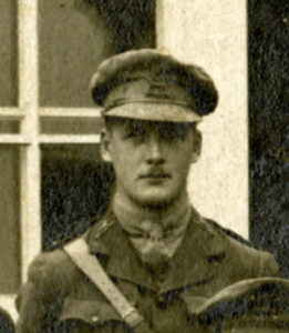 Close-up sepia toned image of a First World War officer with cap and thin moustache