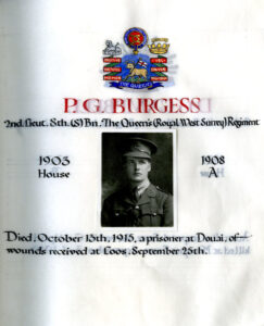 page from WWI book of remembrance featuring photo of P.G. Burgess and symbols of The Queen's (Royal West Surrey Regiment)
