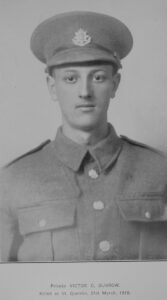 young WWI soldier with East Surrey Regiment cap badge on hat.