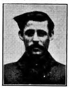 Black and white printed image of WWI soldier with moustache